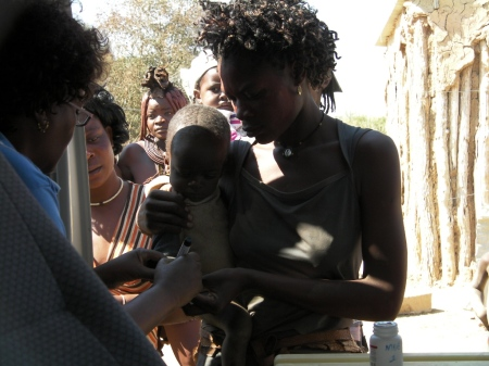 Marking the right thumb of a child immunised as part of Kunene Namibia National Immunisation Days 2011 Round One
